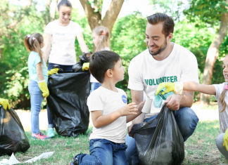 volunteer with young kids
